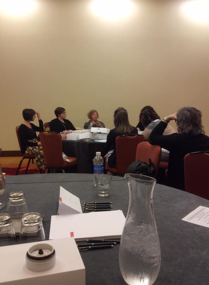 Image of SEW members in roundtable discussion.